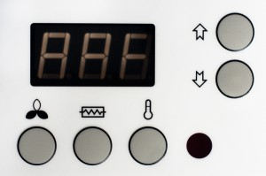 5758318-closeup-of-a-thermostat-with-big-buttons-and-display